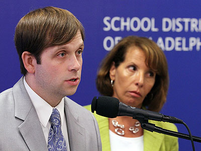 Daniel Piotrowski, executive director of Accountability and Assessment (left), and Francis Newburg, deputy chief of Accountability and Educational Technology (right), answer questions from the media after a press conference to release the Philadelphia School District´s findings about test cheating in their schools. (Michael Bryant / Staff photographer)
