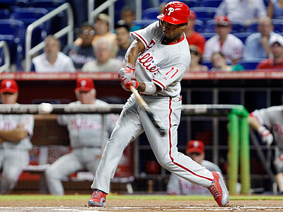 Phillies shortstop Jimmy Rollins led off the game with a solo home run. (Wilfredo Lee/AP)