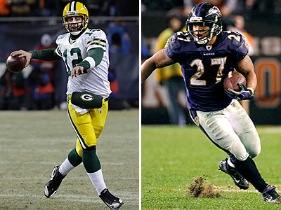 Aaron Rodgers, the top quarterback, outscored Ray Rice, the top running back, by 102 points last season. (AP Photos)