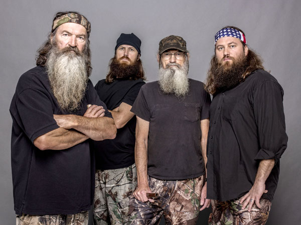 "This 2012 photo released by A&E shows, from left, Phil Robertson, Jase Robertson, Si Robertson and Willie Robertson from the A&E series, ""Duck Dynasty.""  A&E says nearly 12 million birds of a feather caught the season premiere of the hit unscripted series on Wednesday, Aug. 14, 2013.  (AP Photo/A&E, Zach Dilgard)"