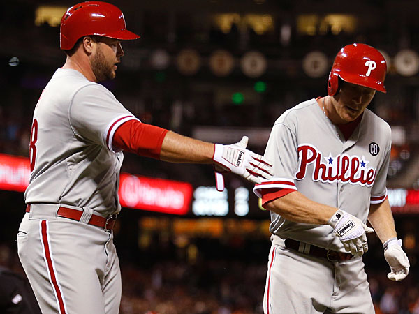Cody Asche is congratulated by Darin Ruf after crossing the plate. (Beck Diefenbach/AP)