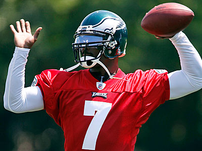 Michael Vick throws a pass during afternoon practice today. (AP Photo/Matt Rourke)