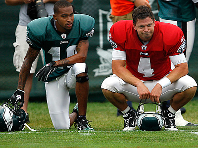 DeSean Jackson and Kevin Kolb kneel on the sideline during training camp practice. (David Maialetti / Staff Photographer)