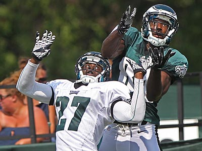 Eagles cornerback Brandon Hughes defends receiver Jason Avant during training camp. (Michael Bryant/Staff Photographer)