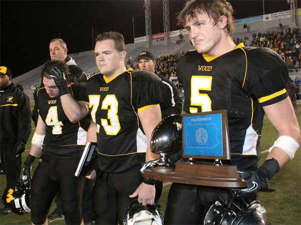The looks on their faces tell you that Archbishop Wood´s players are less than happy with their second-place trophy. Erie Cathedral Prep won the championship game, 24-14. (Steven M. Falk / Staff Photographer)