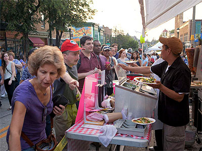 A crowd lines up for a sampling of Mexican food. Several thousand turned out for the latest edition of the Night Market Philadelphia series put on by the Food Trust nonprofit. (Ed Hille / Staff Photographer)