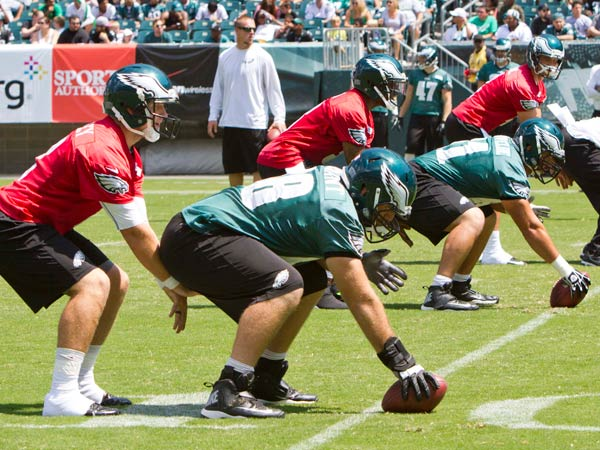 Matt Barkley, Dennis Dixon and G.J. Kinne take snaps during a recent practice. The Eagles released Dixon and Kinne on Friday. (David M Warren/Staff Photographer)