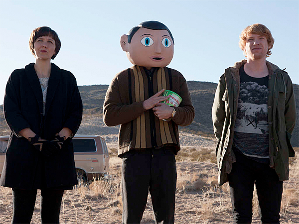 "From left, Maggie Gyllenhaal, Michael Fassbender and Domhnall Gleeson star in ""Frank,"" Lenny Abrahamson´s globe-trotting road pic. (Magnolia Pictures)"