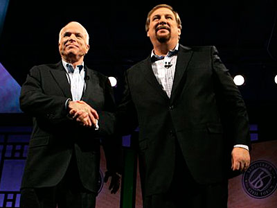 Republican presidential candidate, Sen. John McCain, R-Ariz., left, shakes hands with Pastor Rick Warren after participating in the Compassion Forum at the Saddleback Church on Saturday in Lake Forest, Calif. (AP Photo/Mary Altaffer)<br /><br />