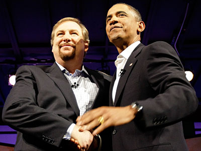 Democratic presidential candidate Sen. Barack Obama, D-Ill., shakes hands with Pastor Rick Warren during the Faith Forum at Saddleback Church in Lake Forrest, Calif. Saturday, Aug. 16, 2008. (AP Photo/Alex Brandon)<br /><br />