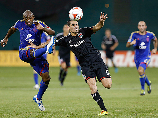 Colorado Rapids defender Marvell Wynne (22) clears the ball in front of D.C. United forward Fabian Espindola (9) in the second half of Sunday´s game at Robert F. Kennedy Memorial Stadium in Washington. (Geoff Burke/USA Today Sports)