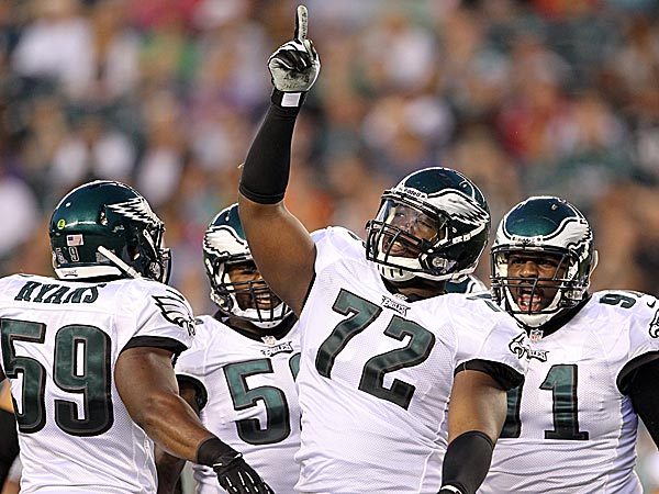 The Eagles´ Cedric Thornton celebrates a tackle with teammates DeMeco Ryans, Trent Cole and Fletcher Cox. (Yong Kim/Staff Photographer)