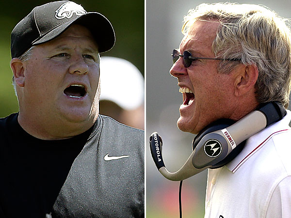 Eagles coach Chip Kelly, left, and former coach Dick Vermeil, right. (AP Photos)