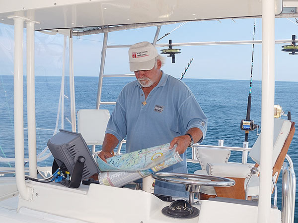 "Bernie Parent at the helm of his boat, ""The French Connection."" (Courtesy of Bernie Parent)"