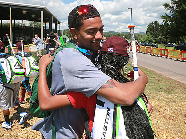 Julian McWilliams hugs Taney´s Mo´ne Davis. (David Swanson/Staff Photographer)