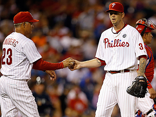 Phillies pitcher A.J. Burnett hands the ball to manager Ryne Sandberg. (Yong Kim/Staff Photographer)