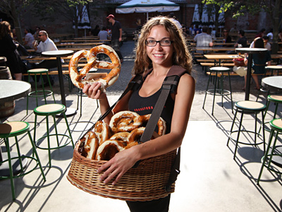 Pretzel girl Katie Roberts with real German pretzels at Frankford Hall. (Michael Bryant / Staff photographer) 