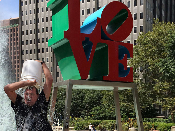 Brent Cronin of Fishtown takes the ALS Ice Bucket Challenge in front of the ´LOVE´ sculpture Monday.