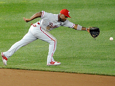 Jimmy Rollins will have an MRI exam today after suffering a groin injury yesterday. (Nick Wass/AP)