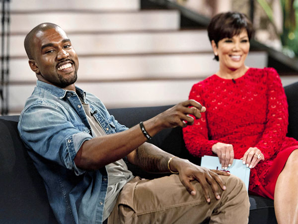 "This Aug. 19, 2013 photo shows singer Kanye West, left, with host Kris Jenner during a taping of her talk show ""Kris,"" in Culver City, Calif. West proclaims his love for Jenner´s daughter, Kim Kardashian, and their daughter North in the interview airing Friday, Aug. 23.  (AP Photo/20th Century Television, Barry J. Holmes)"