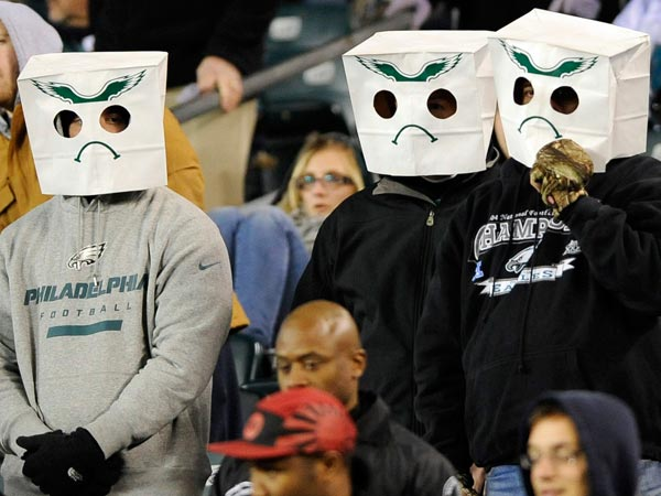 Eagles fans wear paper bags over their heads in the second half of an NFL football game against the Carolina Panthers, Monday, Nov. 26, 2012, in Philadelphia. Carolina won 30-22. (Michael Perez/AP file)