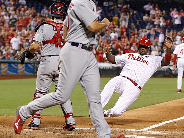 Ryan Howard slides into home plate. (Ron Cortes/Staff Photographer)