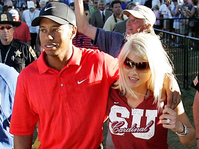 Tiger Woods and ex-wife Elin Nordegren. (AP Photo/Rob Carr, File)