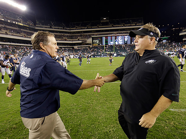 New England Patriots head coach Bill Belichick (left) is renowned for being less than truthful with the media and public. (Matt Rourke/AP)