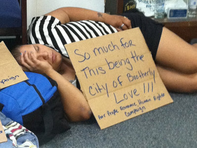 Yesenia Cruz, 33, a homeless woman, slept during a sit-in at a city government office during an August protest on behalf of women and children seeking placement in shelters. (Alfred Lubrano / Staff)