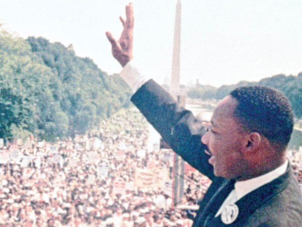 "Dr. Martin Luther King Jr. acknowledges the crowd at the Lincoln Memorial for his ""I Have a Dream"" speech during the March on Washington, D.C., in Aug. 28, 1963."