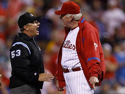 Charlie Manuel shows umpire Greg Gibson where he thought Michael Bourn ran out of the baseline. (AP Photo / Matt Rourke)