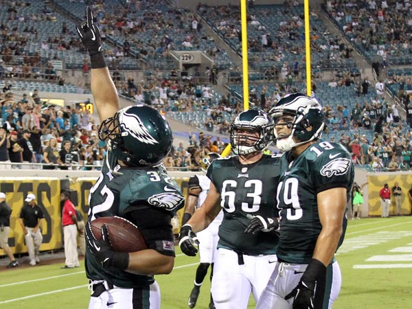 Eagles running back Chris Pol celebrates a touchdown. (Yong Kim/Staff Photographer)