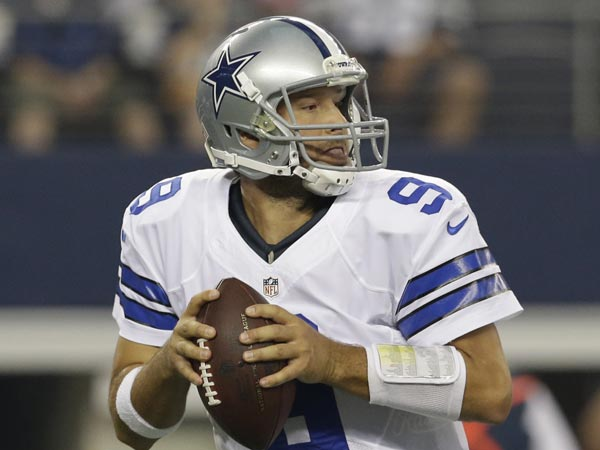 Cowboys quarterback Tony Romo drops back to pass during the first half of an preseason NFL football game, Saturday, Aug. 24, 2013, in Arlington, Texas. (LM Otero/AP)