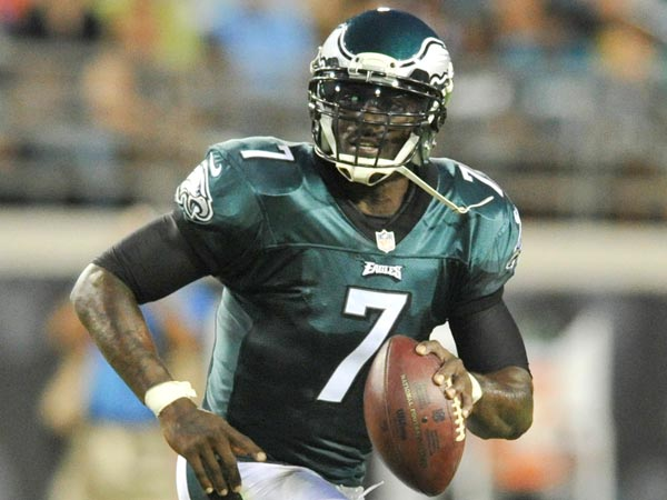 Michael Vick scrambles as he looks for a receiver during the first half of an NFL preseason football game against the Jacksonville Jaguars, Saturday, Aug. 24, 2013, in Jacksonville, Fla. (Stephen Morton/AP)