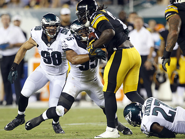 Malcolm Jenkins (bottom), Mychal Kendricks (center) and Connor Barwin (left) go to stop Steelers running back LeGarrette Blount. (Yong Kim/Staff Photographer)