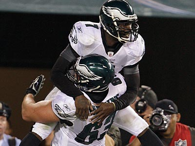 Michael Vick celebrates his 13-yard touchdown run against the Browns on Thursday. (David Maialetti/Staff Photographer)