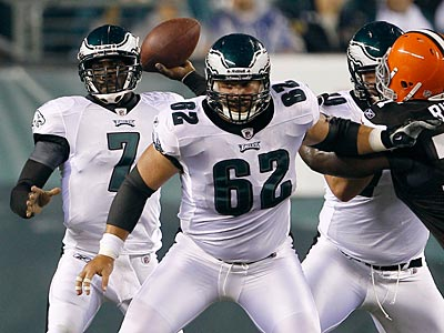 Jason Kelce (62) blocks for Michael Vick as he prepares to throw. (Yong Kim/Staff Photographer)