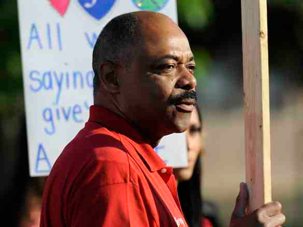 Philadelphia Federation of Teachers President Jerry Jordan joins a recent protest outside Mayfair Elementary over proposed cuts.