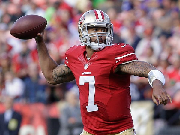 49ers quarterback Colin Kaepernick (7) passes against the Minnesota Vikings during the first quarter of an NFL preseason football game in San Francisco, Sunday, Aug. 25, 2013. (Jeff Chiu/AP)