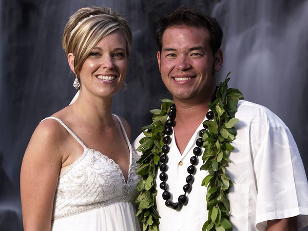 "FILE - This 2008 file image released by TLC, shows Jon Gosselin, right, and his wife Kate Gosselin, from the TLC series ""Jon & Kate Plus 8,"" in Hawaii. Kate Gosselin has filed a lawsuit accusing her ex-husband, Jon, of stealing her hard drive and hacking into her phone and computer to get material for a tell-all book. The federal lawsuit says he took the material for a book called ""Kate Gosselin: How She Fooled the World."" The suit, filed Monday, Aug. 26, 2013, in Philadelphia, says the book was written by her ex-husband´s friend, tabloid writer Robert Hoffman, but has since been pulled from Amazon because the material was obtained illegally. (AP Photo/TLC, Mark Arbeit)"
