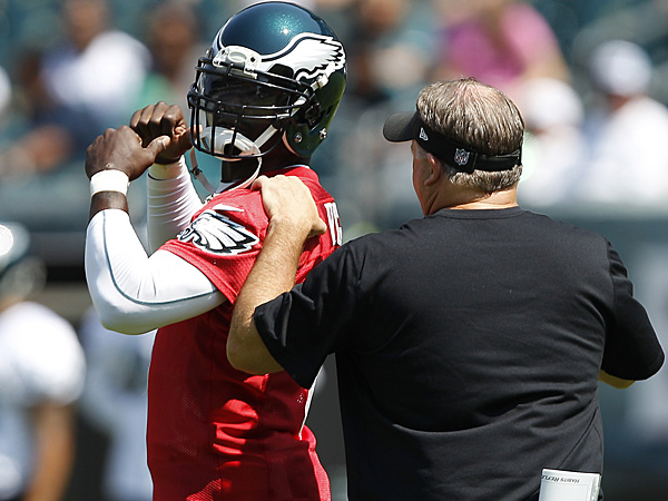 Eagles quarterback Michael Vick (left) and head coach Chip Kelly (right). (David Maialetti/Staff Photographer)