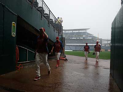 The Phillies leave the field after rain begins to fall during warmups. The game was ultimately postponed. (Ron Cortes/Staff Photographer)