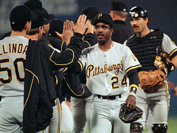 Pittsburgh Pirates Barry Bonds (24) high-fives teammates after the Pirates 13-4 win over the Atlanta Braves in game six of the NLCS Tuesday, Oct. 14, 1992 in Atlanta to even the best of seven series at 3-3. Bonds had a homerun and a hit in the eight-run second inning. (AP Photo/John Swart)