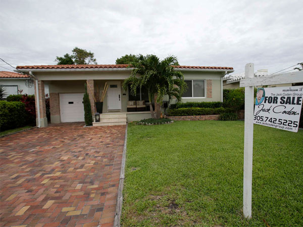 A Surfside, Fla., home. Steady hiring and low mortgage rates have spurred Americans to buy. (Wilfredo Lee / AP)