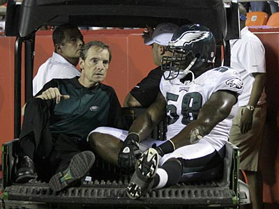 Trent Cole (right) gets carted of the field after injuring his ankle against the Chiefs on Friday. (Yong Kim / Staff Photographer)
