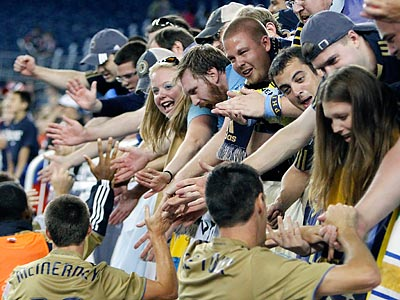 After Saturday´s win, Union players celebrated with fans who traveled to the game from Philadelphia. (Michael Dwyer/AP)