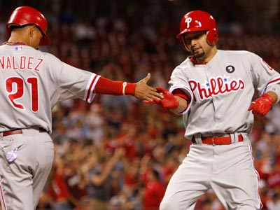 Shane Victorino is greeted at home by Wilson Valdez after Victorino hit a two-run home run. (David Kohl/AP)