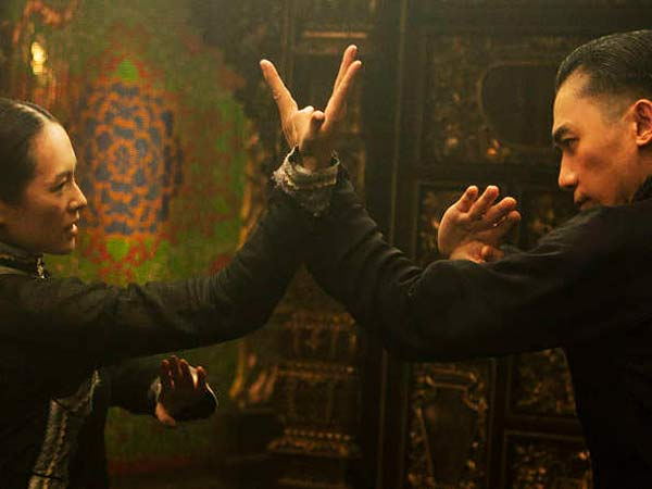 "Ziyi Zhang (left), as Gong Er , and Tony Leung, as Ip Man, face off in more ways than one in ""The Grandmaster."" In real life, Ip Man was credited with training kung fu legend Bruce Lee."
