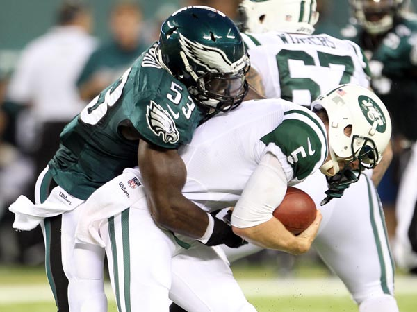Emmanuel Acho sacks Jets quarterback Matt Simms. (Yong Kim/Staff Photographer)