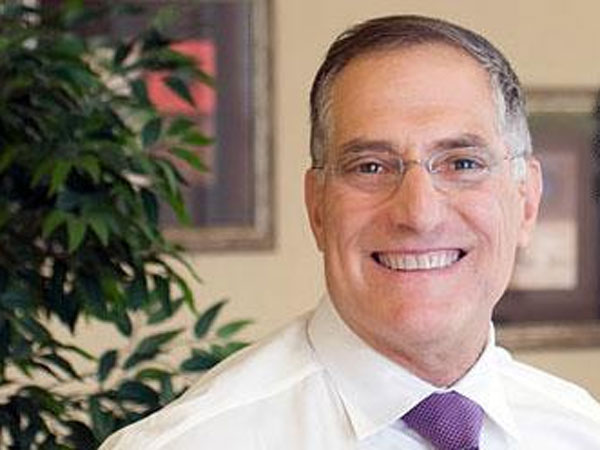 Andrew Bogdanoff, Chairman and CEO of Remington Financial Group. (Photo from merchantcircle.com)